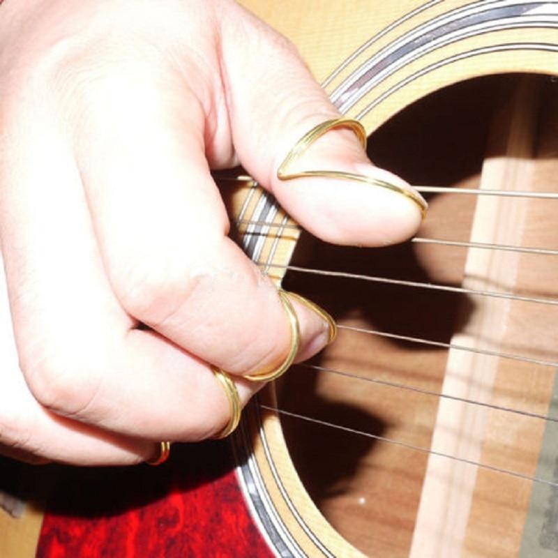 4pcs set finger thumb guitar picks giutar plectrums guitar parts accessories top quality in. Black Bedroom Furniture Sets. Home Design Ideas