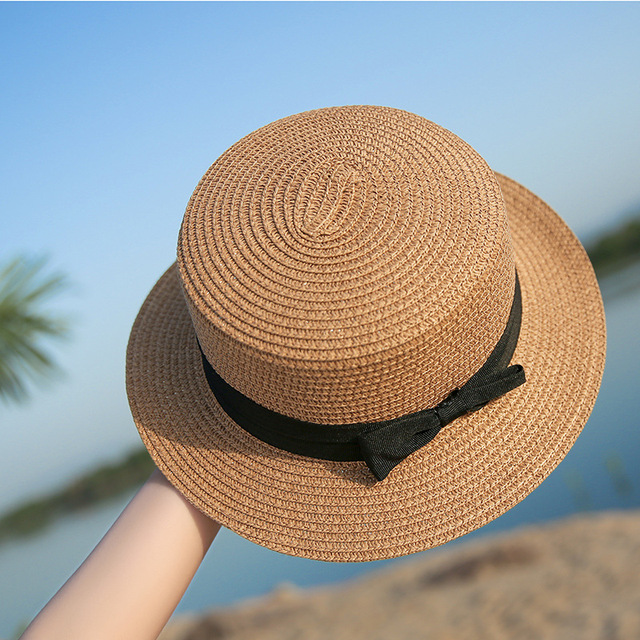 0a0e3cc7 wholesale 2019 flat bow straw hat girls summer sun Hats For Women Beach  boater hat ladies