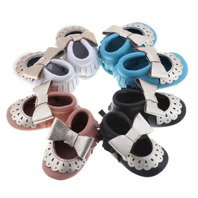 Cuero genuino de calidad superior bebé mocasines borla y el arco del bebé zapatos Bebe recién nacido niño niña inferior suave primeros caminante