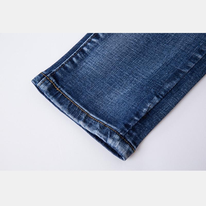 Symmetrischen blume stickerei baumwolle elastische jeans frau pocken bleistift hosen blume lässige mode weichmacher gute qualität Hosen