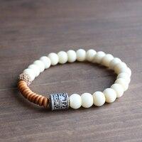 En gros Tibétain bouddhisme Totem Charme & Noix De Tagua Rudraksha Perles Bracelet Extensible Pour Femmes De Yoga Méditation Chakra Bijoux