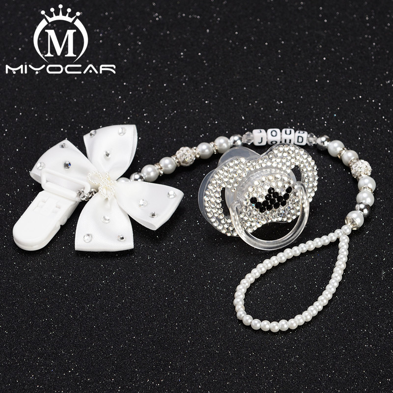 Купить с кэшбэком MIYOCAR Any name white bow bling rhinestone pacifier clip holder dummy clip with  bling black crown pacifier dummy idea gift