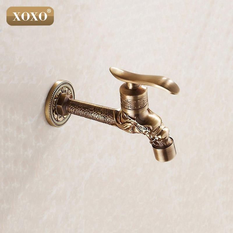 все цены на XOXO Antique bronze Dragon carved tap Animal shape faucet Garden Bibcock washing machine faucet outdoor faucet for Garden 77001B