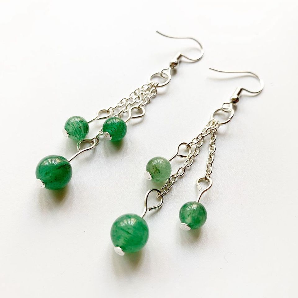 Jade and sterling silver beads with Aventurine cross and sterling silver hook and eye closure.