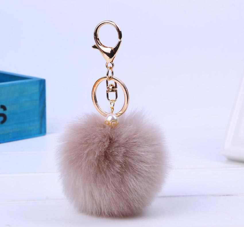 Novo presente de Natal chaveiro pele 8 CM bola pom pom pele chaveiro Carro Saco porta chiavi chave de ouro prata bonito anel de casais jóias