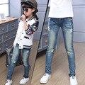 2016 осень новые дети девушки джинсы стрейч ноги брюки Ближний талии узкие брюки повседневные брюки звезда шаблон