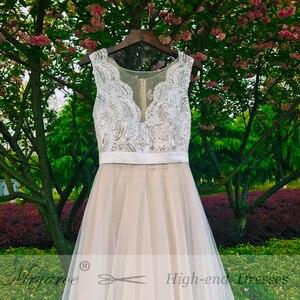 Image 4 - Mryarce plaża suknia ślubna Illusion dekolt koronkowe aplikacje Flowy tiul letnie sukienki suknie ślubne z guzikami
