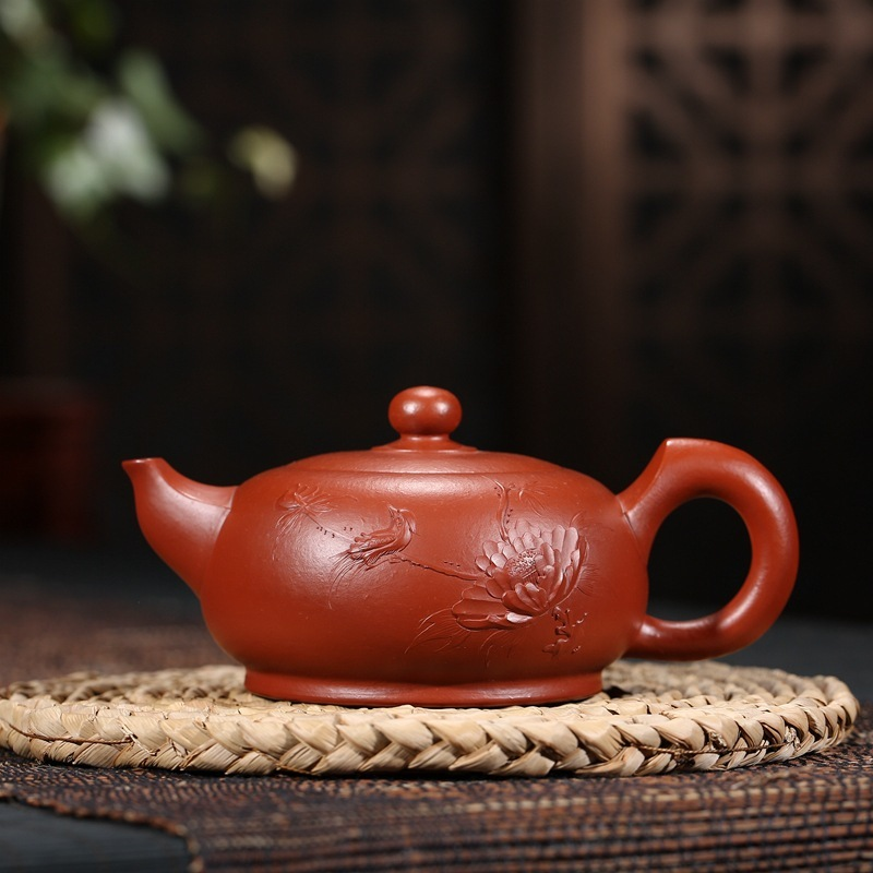 Yixing famous authentic undressed ore recommended lotus rhyme pot gift teapot tea agent undertakes to new productYixing famous authentic undressed ore recommended lotus rhyme pot gift teapot tea agent undertakes to new product