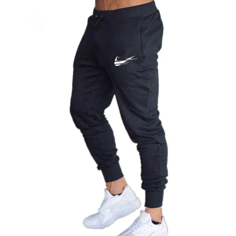 2018 nuevos hombres camisetas de marca, para Hombre Pantalones casuales pantalones de gimnasio para hombres músculo de algodón Fitness entrenamiento hip hop pantalones elásticos