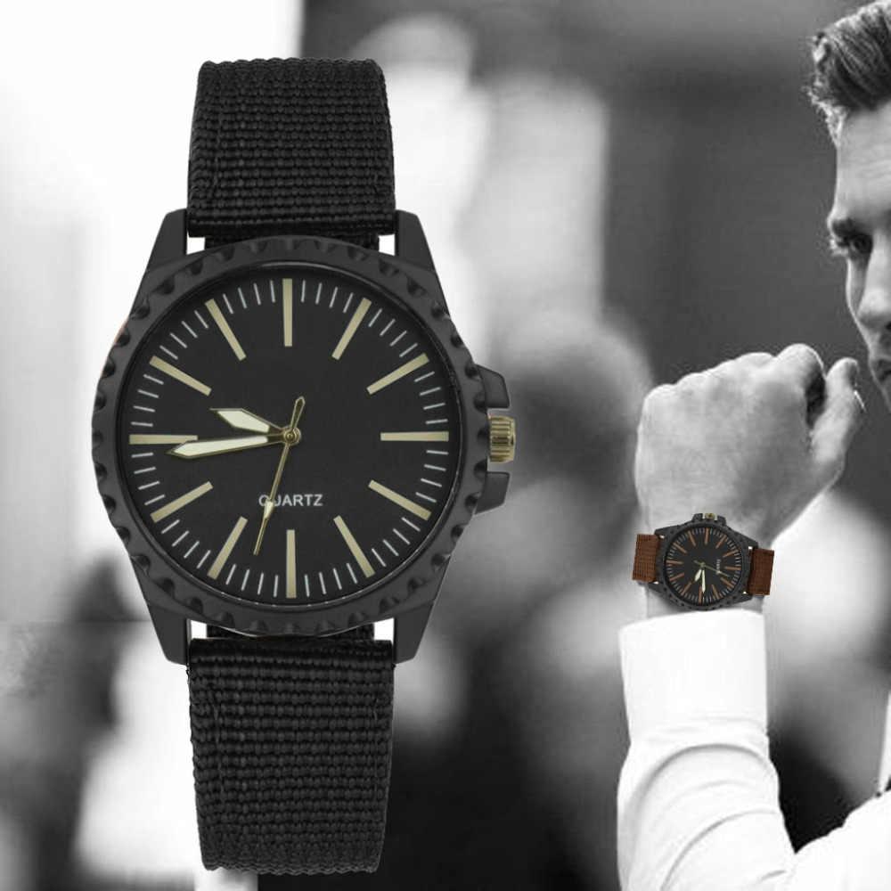 1ef7fca550af Nuevo reloj de los hombres de moda diseño Retro de cuero banda analógica de  aleación de