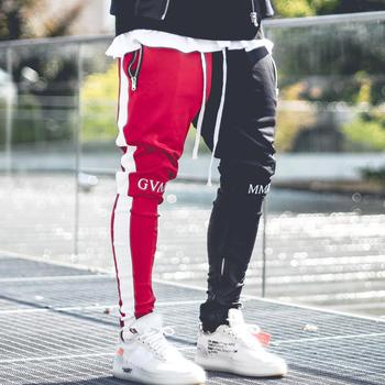 Kwiecień MOMO 2019 mężczyźni Jogger Patchwork spodnie gimnastyczne mężczyźni Fitness kulturystyka spodnie gimnastyczne odzież dla biegaczy spodnie dresowe Hombre tanie i dobre opinie April MOMO Ołówek spodnie Pełnej długości Mieszkanie skinny COTTON spandex Midweight Suknem Hip Hop Elastyczny pas