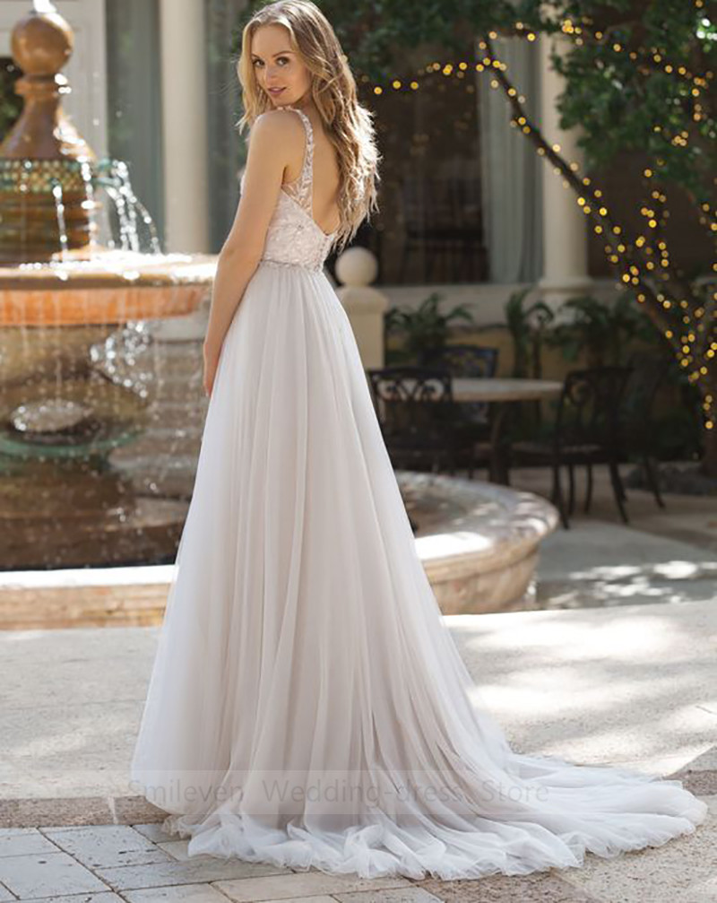 Beach Wedding Dress 2019 V Neck A Line Appliques Beaded Bride Dress With Crystal Floor Length Wedding Gown For Girl in Wedding Dresses from Weddings Events