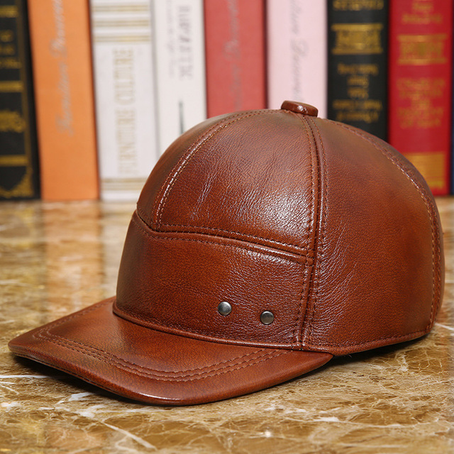 099685dae79 100% Genuine Leather Hat Male Fashion Baseball Cap Adjustable Cowhide  Outdoor Leisure Warmth Ear Protectors