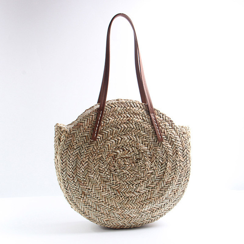 2018 new grass round straw bag beach woven bag shoulder simple fashion atmospheric holiday handbag2018 new grass round straw bag beach woven bag shoulder simple fashion atmospheric holiday handbag