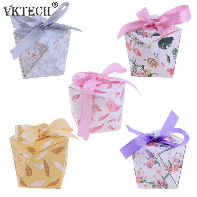 50pcs Octagonal Bowknot DIY Paper Candy Box Valentines Day Wedding Gifts(China)