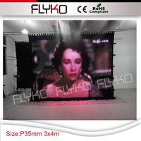 High bright P35mm new hot sell led lights display video curtain cloth 3m by 4m for stage entertainment occasion