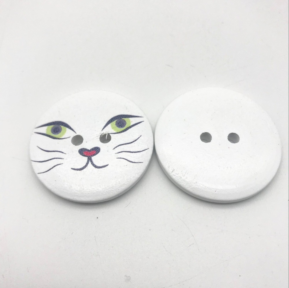pack of 10 white buttons with a red heart approx 12mm dia white on back