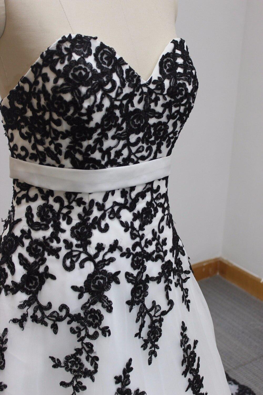 Reale pezzi in pizzo nero appliques bianco tulle sweetheart A line abito da  sposa nero + bianco classico in Reale pezzi in pizzo nero appliques bianco  tulle ... 91c0f0d163b