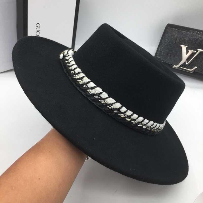 ¿Lana negra clásica  Sombrero de ala plana de moda de ala ancha bump  sombreros 837e0520840