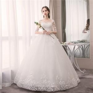 Image 1 - EZKUNTZA O Neck Half Sleeve Wedding Dress Fashion Slim Lace Embroidery Lace Up Plus Size Custom Made Wedding Gown Robe De Mariee