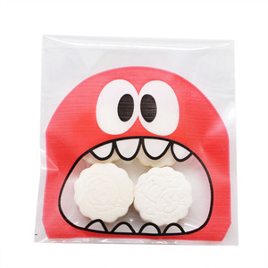 Image 5 - 50Pcs Cute Big Teeth Mouth Monster Plastic Bag Wedding Birthday Cookie Candy Gift Packaging Bags OPP Self Adhesive Party Favors
