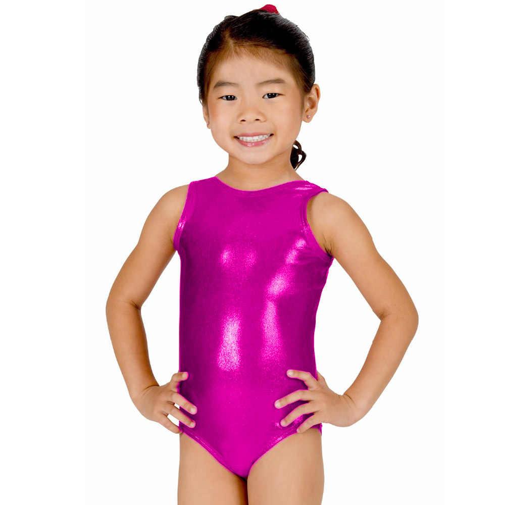 little girl leotard Little girl gymnast in leotard at white studio background. Sporty..