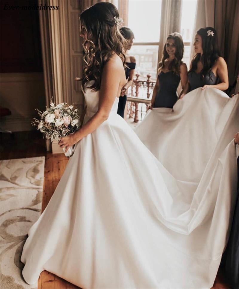 Sweetheart 2020 Satin Modest A-Line Wedding Dresses Court Train Garden Beach Bridal Gowns Plus Size Cheap Robe Mariage