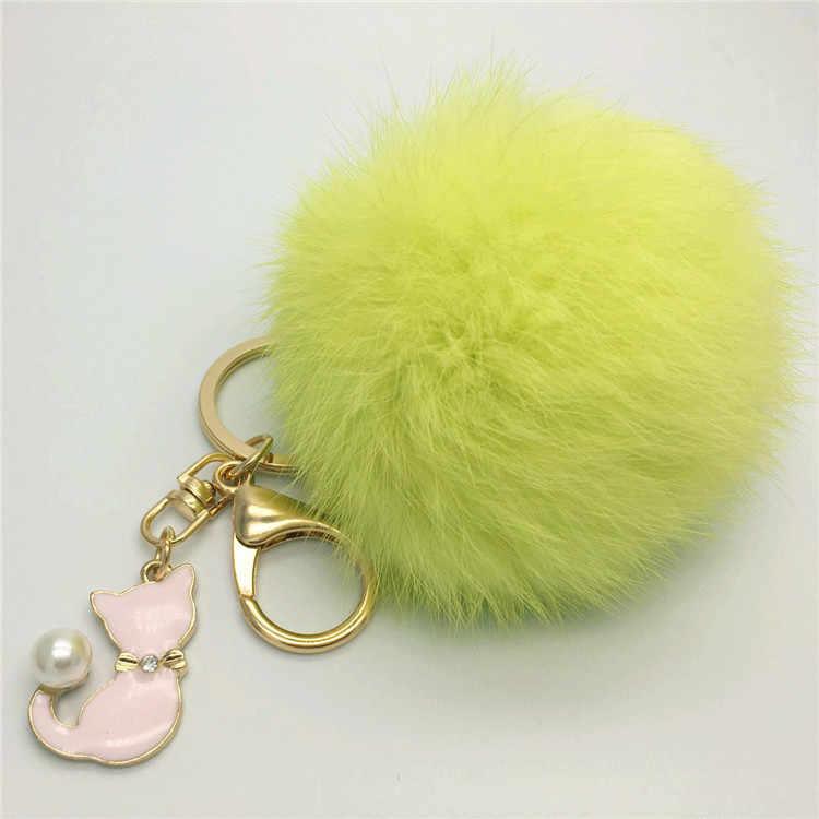 O novo pingente de pele carro chaveiro saco pingente jóias coelho real cabelo bola acessórios k1100