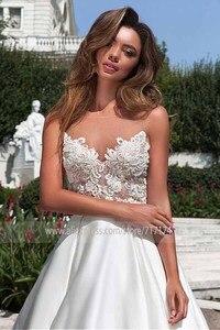 Image 2 - Scoop Sheer Neckline Lace Applique ซาติน A Line ชุดแต่งงานกับ Backless Chapel Train สวนชุดเจ้าสาว vestido de novia