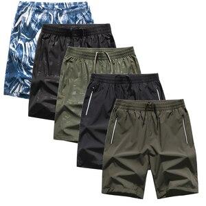 Image 1 - Pantalones cortos de camuflaje para hombre, bañador masculino de talla grande, 5 uds., 8XL, Bermudas, ropa de playa, 1299