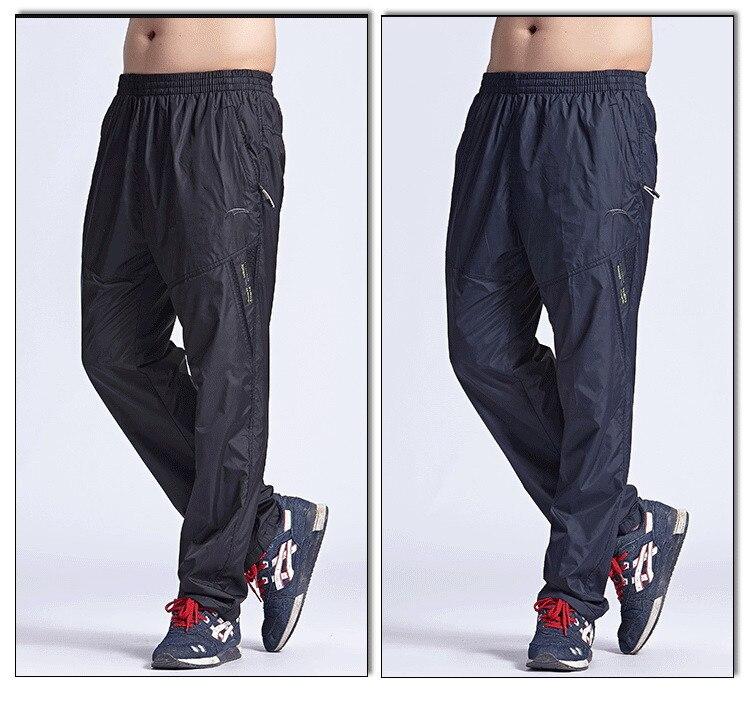 Novo secagem rápida calças ativas dos homens