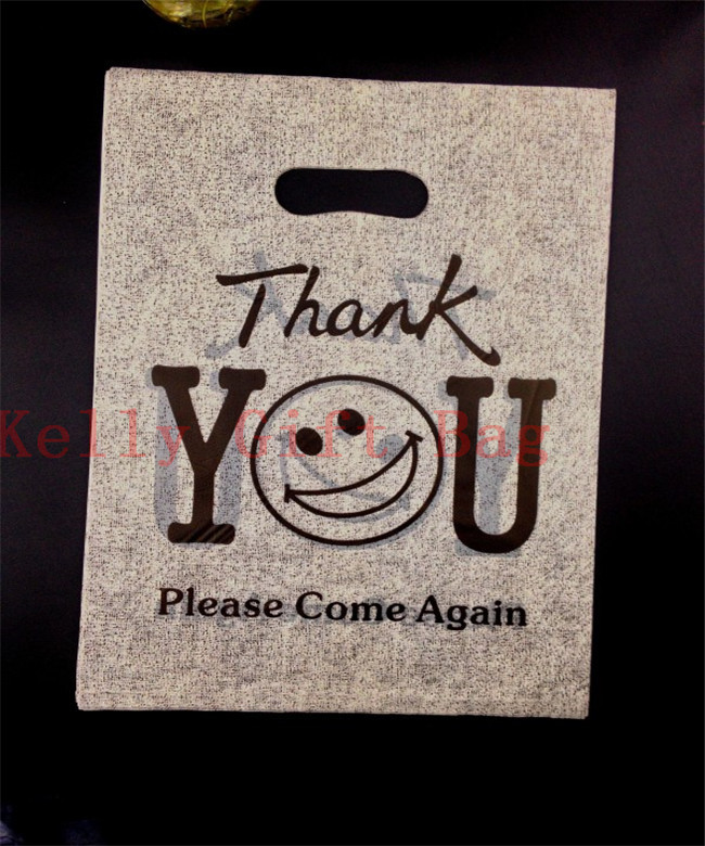 25x35cm Black Smile Face Print Large Plastic Ping Bags With Handle 50pcs Thick Clothes Gift Packaging In Jewelry Display
