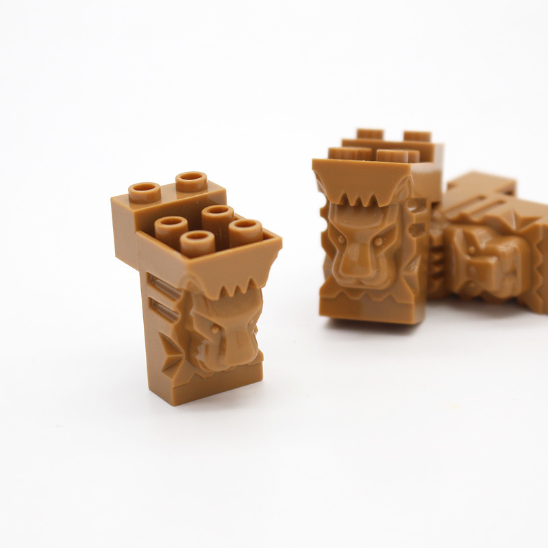 LEGO Brick Tan Modified 2 x 3 x 3 with Cutout and Lion Head