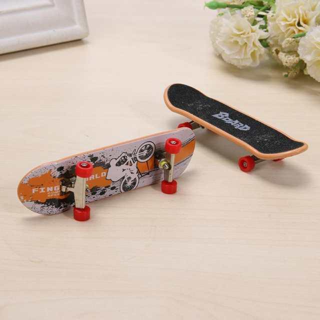 7738296efd 2pcs/lot Fashion Mini Finger Skating Board Table Game Toy Alloy Skateboard  Novelty Kids Toys Children Gifts for Boys