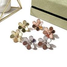 6e185ae9895c Moda marca flor del trébol pendientes de acero de titanio mujeres boda  joyería nupcial regalos oro plata oro rosa oro