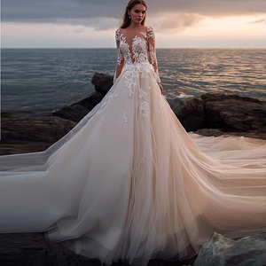 Image 1 - Сексуальное кружевное свадебное платье с аппликацией и длинным рукавом 2020 иллюзионное платье с высоким воротом и открытой спиной свадебное платье со шлейфом официальное платье