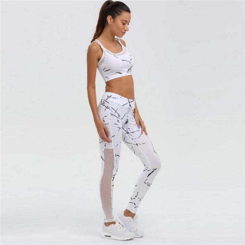 2018 New Patchwork Tuta Crop Top Serbatoi E Leggings Sportivi Skinny  Abbigliamento Estate 2 Pezzi Hollow Abbigliamento Donna in 2018 New Patchwork  Tuta Crop ... be82085f588