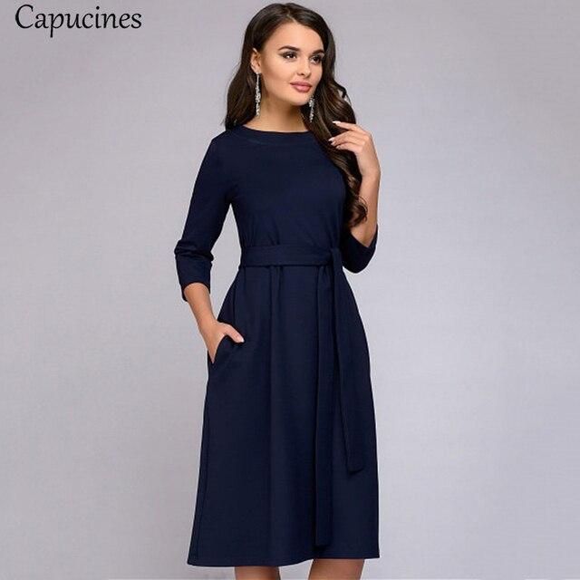 فستان كاجوال نسائي ربيعي وخريفي بلون واحد وأكمام ثلاثة أرباع وجيوب واسعة ورقبة دائرية فساتين نسائية