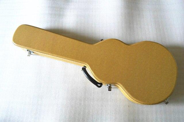 Usine en Chine ventes directes de guitare électrique boîte en cuir boîte de piano ventes au comptant crocodile en cuir emballage jaune toile