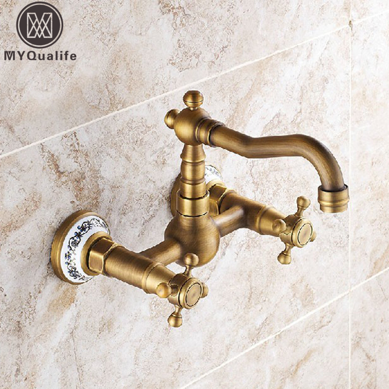 Antique Brass Dual Handles Bathroom Kitchen Sink Faucets Wall Mounted Swivel Spout Two Holes Kitchen Mixer Taps antique brass swivel spout dual cross handles kitchen