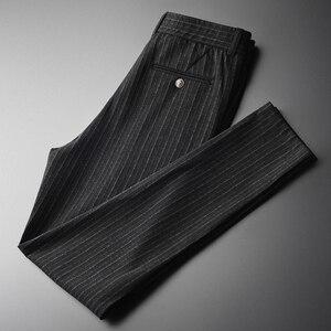 Image 1 - Minglu w pionowe paski męskie spodnie Plus rozmiar 4xl luksusowa miękka przędza barwiona jesień mężczyźni dorywczo spodnie Slim Fit elastyczne spodnie obcisłe mężczyzn