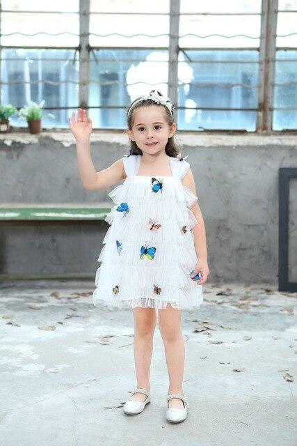 b190487534fb1 Ttoncen أوروبا الصيف الطفل بنات الأميرة اللباس ملابس أطفال كارتون 3d فراشة  اللباس كعكة الإضافية ل