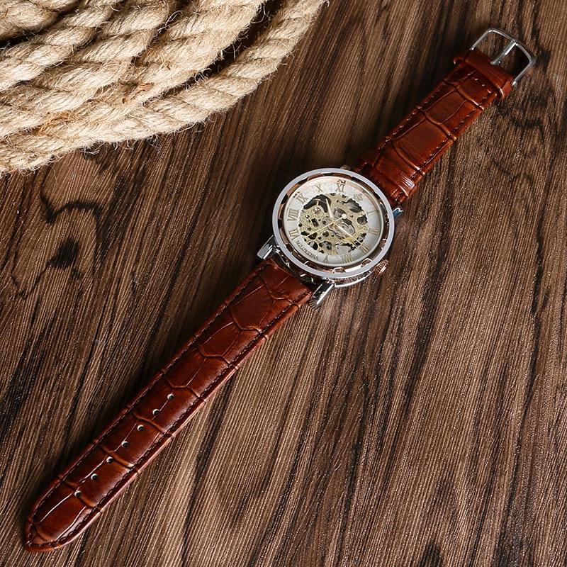 a70b93d2398 Top Marca MG. ORKINA Esqueleto Único dos homens Mão Mecânica Do Vento  Assista Números Romanos Relógio de Pulso Com pulseira de Couro Genuíno  Relógio ...