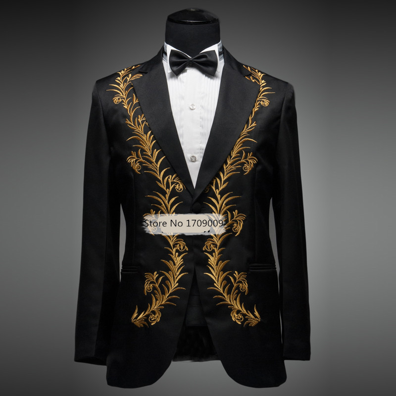 Men's gold metallic floral pattern tuxedo vest with black lapel, adjustable full back, and 4 buttons. Available in blue, gold, purple, and red. Matching ties sold .