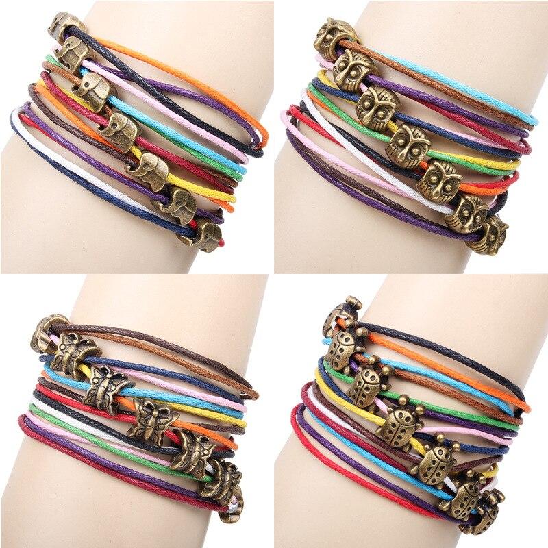 1191b809ca Estilo punky colorido vela línea marrón mariposa Fox elefante Tigre cabeza  tortuga diseño nueva tendencia de cuero pulsera de la joyería