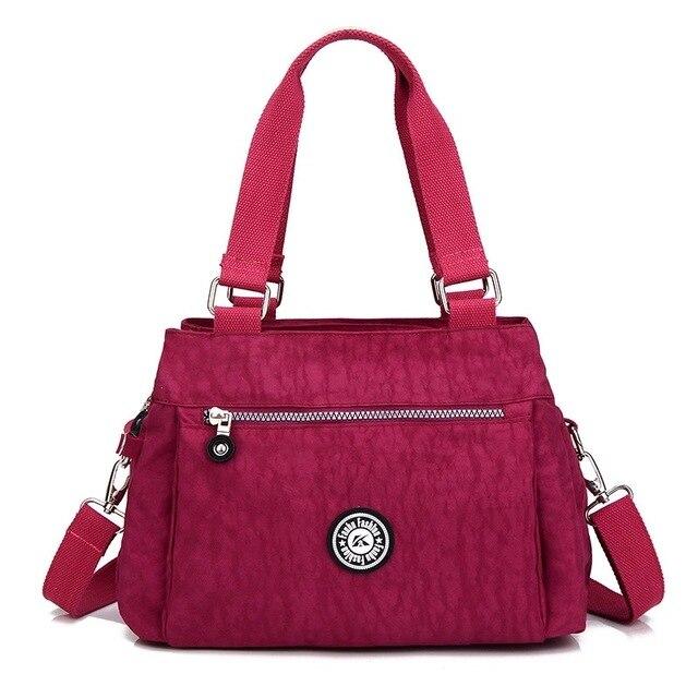 grandes variedades sitio web profesional ahorre hasta 80% € 25.32 |KVKY marca nuevo mujeres bolso impermeable de la luz de tela de  nylon bolsa de hombro de moda en Cubos de Bolsos y maletas en  AliExpress.com ...