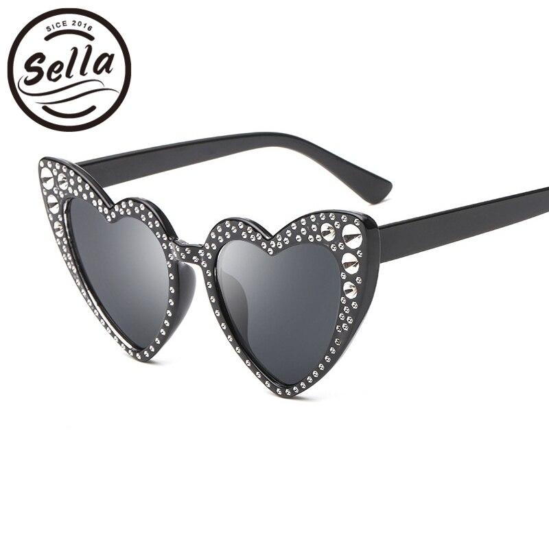 Sella nuevo estilo europeo señoras atractivas Corazón de sol colorido lente tinte cristal decoración de gran tamaño gafas de sol de las mujeres