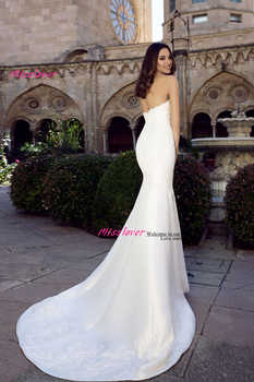 Luxury Pearls Sexy strapless sleeveless Mermaid Wedding Dress 2019 New Beach Bridal Gown Appliques Lace Vestido De Novia