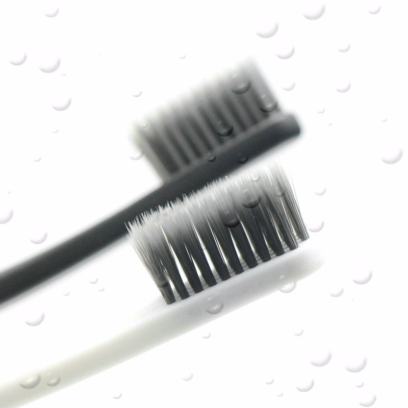 50Pcs Set Hotel Disposable Toothbrush Portable Bamboo Charcoal Tooth Cleaning Charcoal Travel Tooth Brush Teeth Cleaning Tools in Toothbrushes from Beauty Health
