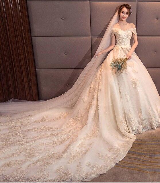 85885530d € 159.73 25% de DESCUENTO|2018 Alta Costura A Line vestido de novia para  mujer apliques dorados en el tren grande vestidos de novia sin mangas ...
